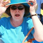 Jane in blue.  Windy day!  Hold on to the hat!