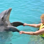 Grandma dancing with a dolphin