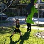 Batgirl takes a swing at a pinata