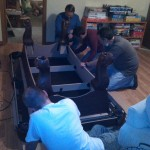 Guys putting a pool table together.