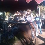 Riding a big pony