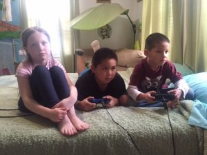 Kids playing PlayStation