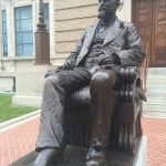 Left some beads on the library statue guy