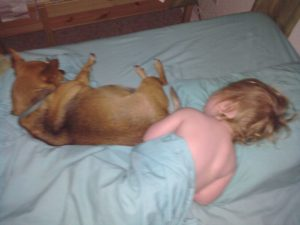 Rusty napping with baby Ivy