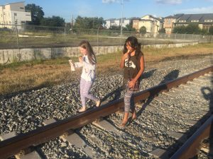 Walking illegally on the railroad track to the art gallery